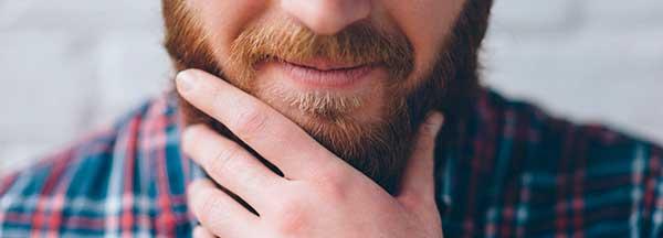 toucher la barbe